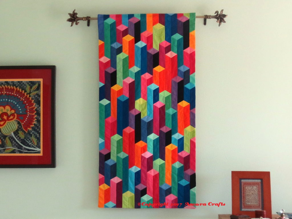 modern tumbling blocks quilt at home